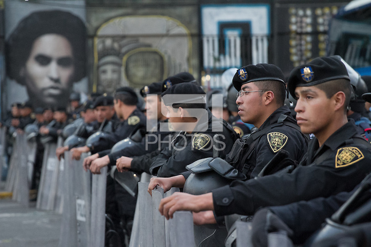 Mexican police officers in riot gear formed a perimeter around a bus of USA fans arriving for the USA vs. Mexico World Cup Qualifier at Azteca stadium in Mexico City, Mexico on March 26, 2013.