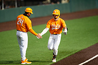 Tennessee Volunteers catcher Connor Pavolony (17) celebrates a home run with assistant coach Josh Elander (24) against the Vanderbilt Commodores on Robert M. Lindsay Field at Lindsey Nelson Stadium on April 17, 2021, in Knoxville, Tennessee. (Danny Parker/Four Seam Images)