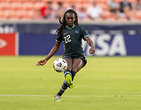 HOUSTON, TX - JUNE 13: Michelle Alozie #22 of Nigeria passes the ball during a game between Nigeria and Portugal at BBVA Stadium on June 13, 2021 in Houston, Texas.