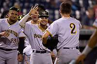 Bradenton Marauders Jase Bowen (2) high fives Francisco Acuna (3) after scoring a run on aJackson Glenn (not shown) home run during Game Three of the Low-A Southeast Championship Series against the Tampa Tarpons on September 24, 2021 at George M. Steinbrenner Field in Tampa, Florida.  (Mike Janes/Four Seam Images)