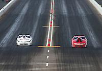 Feb 22, 2015; Chandler, AZ, USA; NHRA pro stock driver Erica Enders-Stevens (right) races alongside Greg Anderson during the Carquest Nationals at Wild Horse Pass Motorsports Park. Mandatory Credit: Mark J. Rebilas-