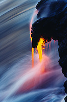 Lava flowing into Pacific Ocean, after flowing seven miles downhill from vent of Kilauea Volcano. Hawaii. USA