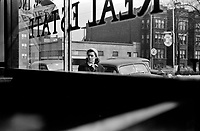 Passerby: Looking out of a building on 47th Street in Chicago, Illinois. 1941.<br /> <br /> Edwin Rosskam.