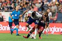 FOXBOROUGH, MA - AUGUST 18: Ramon Abila #32 of D.C. United and Andrew Farrell #2 of New England Revolution battle for the ball during a game between D.C. United and New England Revolution at Gillette Stadium on August 18, 2021 in Foxborough, Massachusetts.
