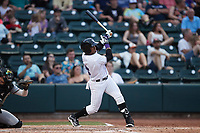 Yoelqui Cespedes (15) of the Winston-Salem Dash follows through on his swing during the game against the Greensboro Grasshoppers at Truist Stadium on June 19, 2021 in Winston-Salem, North Carolina. (Brian Westerholt/Four Seam Images)