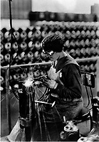 Acetylene welding on cylinder water jacket.  1918.  (Army)<br /> Exact Date Shot Unknown<br /> NARA FILE #:  111-SC-35757<br /> WAR & CONFLICT BOOK #:  544
