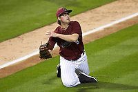 South Carolina Gamecocks relief pitcher Julian Bosnic (18) makes a throw to first base against the North Carolina Tar Heels at Truist Field on April 6, 2021 in Charlotte, North Carolina. (Brian Westerholt/Four Seam Images)