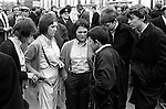 Football supports gather outside Chelsea Football Club for a match against Queens Park Rangers. Three young girls with boys, the girls are dressed in the fashion of the time as Bovver Girls. They wear clothes that mimic boys attire, high waisted trousers,  boys shirts and braces.  London England. 1970