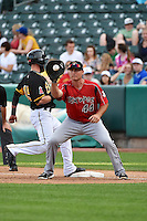 Clint Robinson (44) of the Albuquerque Isotopes on defense against the Salt Lake Bees at Smith's Ballpark on May 21, 2014 in Salt Lake City, Utah.  (Stephen Smith/Four Seam Images)