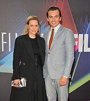 """Aimee Mullins and Rupert Friend at the 65th BFI London Film Festival """"The French Dispatch"""" Headline gala, Royal Festival Hall, Belvedere Road, on Sunday 10th October 2021, in London, England, UK. <br /> CAP/CAN<br /> ©CAN/Capital Pictures"""