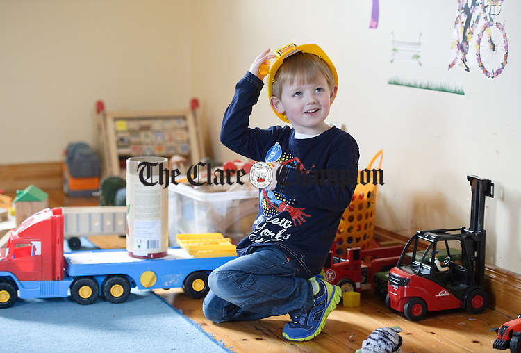 Dylan Lavin playing with toys during a Pyjama Day party at Teach Spraoi, Toonagh as part of the annual Pyjama Day for Autism. Photograph by John Kelly.
