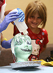 Hayley WHitson, 8, helps Radioactive Rachel during a Mad Science program at the Carson City Library, in Carson City, Nev., on Tuesday, July 15, 2014.<br /> Photo by Cathleen Allison