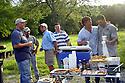 Jeff Tunks, Nash Roberts, Justin Frey, Randy Pierce, John Besh, and Greg Reggio gathered for outdoor cookout before frog hunt, June 29, 2005..(Cheryl Gerber Photo)
