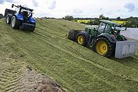Germany, Biogas plant / DEUTSCHLAND, Damnatz im Wendland, Hof und Biogasanlage von Horst Seide, John Deere und New Holland Traktor mit Dieselantrieb beim Maissubstrat schieben