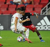 WASHINGTON, DC - JULY 7: Yordi Reyna #29 of D.C. United battles for the ball with Carlos Mora #17 of Liga Deportiva Alajuense during a game between Liga Deportiva Alajuense  and D.C. United at Audi Field on July 7, 2021 in Washington, DC.