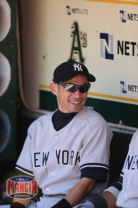 OAKLAND, CA - JUNE 13:  Ichiro Suzuki #31 of the New York Yankees gets ready in the dugout before the game against the Oakland Athletics at O.co Coliseum on Thursday June 13, 2013 in Oakland, California. Photo by Brad Mangin