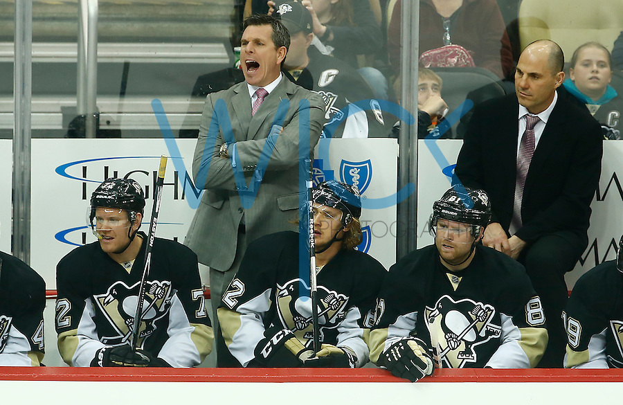 Head coach Mike Sullivan of the Pittsburgh Penguins yells from the bench in the third period against the Nashville Predators during the game at Consol Energy Center in Pittsburgh, Pennsylvania on March 31, 2016. (Photo by Jared Wickerham / DKPS)