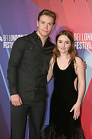 """Will Poulter and Kaitlyn Dever attend the European premiere of """"Dopesick"""" at The Mayfair Hotel during the 65th BFI London Film Festival in London. OCTOBER 13th 2021<br /> <br /> REF: SLI 21561 .<br /> Credit: Matrix/MediaPunch **FOR USA ONLY**"""
