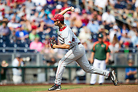 Arkansas Razorbacks pitcher Keaton McKinney (11) delivers a pitch to the plate during the NCAA College baseball World Series against the Miami Hurricanes on June 15, 2015 at TD Ameritrade Park in Omaha, Nebraska. Miami beat Arkansas 4-3. (Andrew Woolley/Four Seam Images)