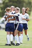 Lori Chalupny is congratulated by Shannon Boxx, center, Lindsat Tarpley, right and Brandi Chastain, back right, after scoring her first goal on the USWNT against Mexico.in Albuquerque, NM, May 9. 2004. The USA won 3-0.