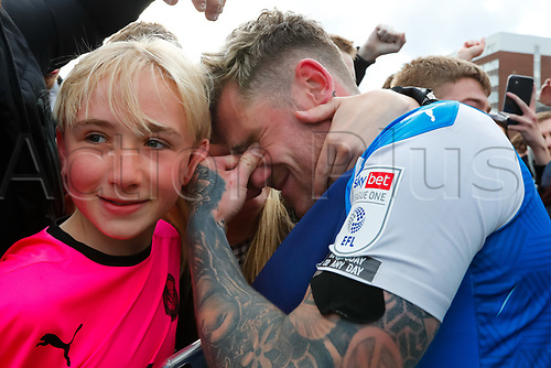 1st May 2021; Weston Homes Stadium, Peterborough, Cambridgeshire, England; English Football League One Football, Peterborough United versus Lincoln City; Sammie Szmodics of Peterborough United is tearful with his family as he celebrates outside The Weston Homes Stadium after Peterborough United win promotion to the EFL Championship