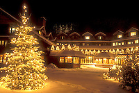 AJ5892, Trapp Family, resort, lodge, inn, hotel, Christmas tree, Stowe, decorations, holiday, evening, winter, Vermont, The Trapp Family Lodge in Stowe is elegantly decorated with white lights for the Christmas holiday season on a snow covered night in Stowe in Lamoille County in the state of Vermont. A Christmas tree with tiny white lights is displayed outside.