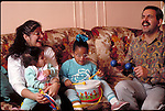 vision impaired girl playing with parents and sister