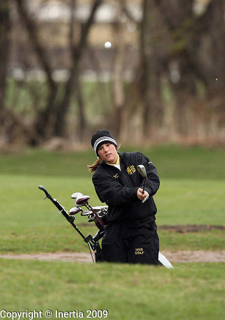 SIOUX FALLS, SD - APRIL 27:  Kendra Cersosimo of Mitchell chips onto the 12th green during the Sioux Falls Invitational Golf Tournament Monday at Elmwood.(Photo by Dave Eggen/Inertia)