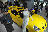 A security guard walks past a Dongfeng Sports Saloon which is claimed as is one of self-owned intellectual property rights type of motor vehicles in Dongfeng Motor Corparation at the 2006 International Automotive Exhibition in Beijing, China.