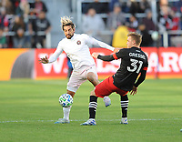 WASHINGTON, DC - MARCH 07: Rodolfo Pizarro #10 of Inter Miami CF battles the ball with Julian Gressel #31 of D.C. United during a game between Inter Miami CF and D.C. United at Audi Field on March 07, 2020 in Washington, DC.