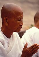 Praying Nun  Buddhist. Vientiane, Laos  That Luang Festival