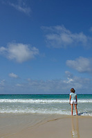 Girl (12) contemplating ocean from beach, Punta Cana, Dominican Republic