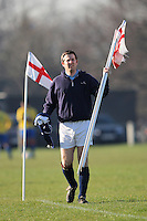 A Wounded Knee FC player carries corner flags prior to a Hackney & Leyton Sunday League match at Hackney Marshes - 10/02/08 - MANDATORY CREDIT: Gavin Ellis/TGSPHOTO - Self billing applies where appropriate - Tel: 0845 094 6026