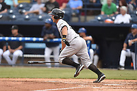 Augusta GreenJackets catcher Jared Deacon (19) swings at a pitch during a game against the Asheville Tourists on April 28, 2015 in Asheville, North Carolina. The Tourists defeated the GreenJackets 7-3. (Tony Farlow/Four Seam Images)