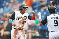 Quad Cities River Bandits first baseman Dexture McCall (27) fist bumps Christian Correa (9) after scoring a run during a game against the Bowling Green Hot Rods on July 24, 2016 at Modern Woodmen Park in Davenport, Iowa.  Quad Cities defeated Bowling Green 6-5.  (Mike Janes/Four Seam Images)