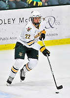 27 January 2012: University of Vermont Catamount defenseman Blake Doerring, a Freshman from Chanhassen, MN, initiates a rush against the Northeastern University Huskies at Gutterson Fieldhouse in Burlington, Vermont. The Catamounts fell to the Huskies 8-3 in the first game of their 2-game Hockey East weekend series. Mandatory Credit: Ed Wolfstein Photo