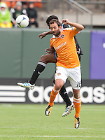 San Francisco, California - Saturday March 17, 2012: Adam Moffat jumps for the ball during the MLS match at AT&T Park. Houston Dynamo defeated San Jose Earthquakes  1-0