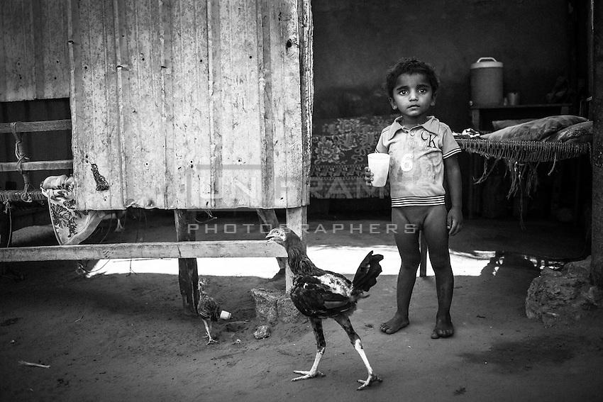 Brother of malnourished 1 year old Aisha in his house. Bayt al-Faqih, Yemen