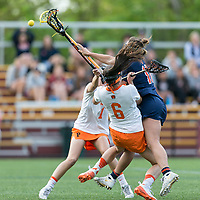 Newton, Massachusetts - May 11, 2018: NCAA Division I. In overtime, Princeton University (white) defeated Syracuse University (blue), 12-11, at Newton Campus Lacrosse Field.<br /> Overtime action.