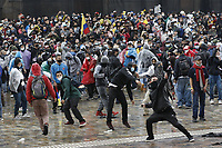 BOGOTA, COLOMBIA - APRIL 28 : People throw stones to police during a national strike Against the Duque package and the tax reform on April 28, 2021 in Bogota, Colombia. Colombia has the minimum wage around $ 250 per month where people are unhappy about corruption, unemployment, and inequality by Government. (Photo by Leonardo Munoz/VIEWpress)