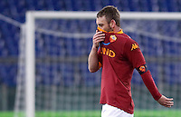 Calcio, ottavi di finale di Coppa Italia: Roma vs Atalanta. Roma, stadio Olimpico, 11 dicembre 2012..AS Roma midfielder Daniele De Rossi leaves the pitch at the end of the Italy Cup last-16 tie football match between AS Roma and Atalanta at Rome's Olympic stadium, 11 December 2012..UPDATE IMAGES PRESS/Isabella Bonotto
