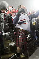 Under a heavy snowfall, a USA fan wearing a kilt watches the USA Men's National Team's World Cup Qualifier against Costa Rica  at Dick's Sporting Good Park in Commerce City, CO on March 22, 2013.