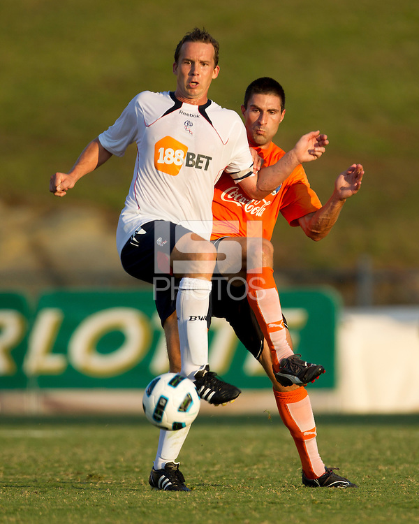 Charlotte Eagles Defender Brady Bryant defends against Bolton Wanderers striker Kevin Davies.  The Charlotte Eagles currently in 3rd place in the USL second division played a friendly against the Bolton Wanderers from the English Premier League on 7/14/10 losing 3-0.