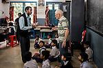 Father Laborde speaks to a teacher at Ekpranta Nagar School at Howrah. West Bengal, India, Arindam Mukherjee/Agency Genesis
