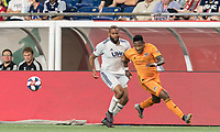 FOXBOROUGH, MA - JUNE 29: Romell Quioto #31 attempts to receive pass as Andrew Farrell #2 defends during a game between Houston Dynamo and New England Revolution at Gillette Stadium on June 29, 2019 in Foxborough, Massachusetts.