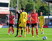 Oxford United's Sean Clare is shown a yellow card by referee Andy Davies<br /> <br /> Photographer Chris Vaughan/CameraSport<br /> <br /> The EFL Sky Bet League One - Saturday 12th September 2020 - Lincoln City v Oxford United - LNER Stadium - Lincoln<br /> <br /> World Copyright © 2020 CameraSport. All rights reserved. 43 Linden Ave. Countesthorpe. Leicester. England. LE8 5PG - Tel: +44 (0) 116 277 4147 - admin@camerasport.com - www.camerasport.com - Lincoln City v Oxford United