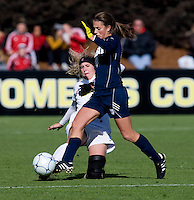 Courtney Verloo (5) of Stanford tries to tackle the ball away from Mandy Laddish (2) of Notre Dame during the final of the NCAA Women's College Cup at WakeMed Soccer Park in Cary, NC.  Notre Dame defeated Stanford, 1-0.