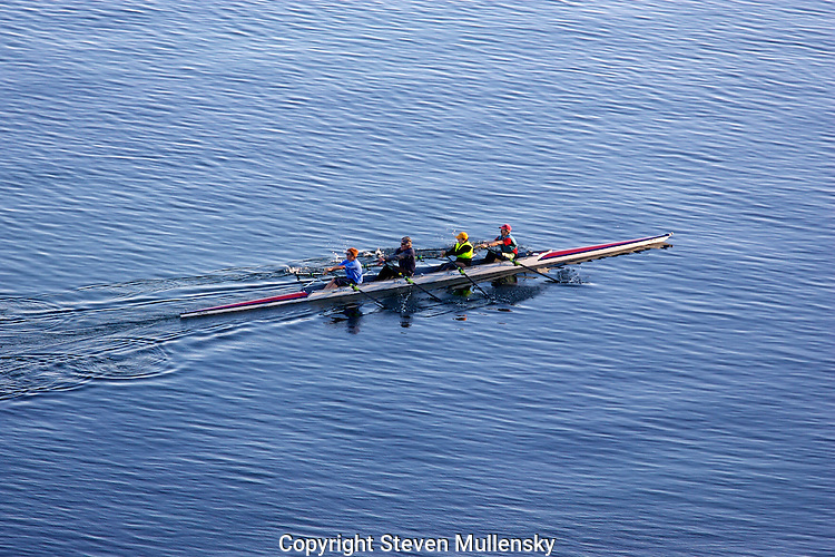 A four person sculling crew gets in a late afternoon workout session on Port Townsend Bay.