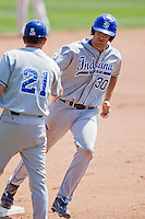 Jon Hedges (30) of the Indiana State Sycamores is congratulated by Head Coach Rick Heller (21) after hitting a home run during a game against the Evansville Purple Aces in the 2012 Missouri Valley Conference Championship Tournament at Hammons Field on May 23, 2012 in Springfield, Missouri. (David Welker/Four Seam Images)