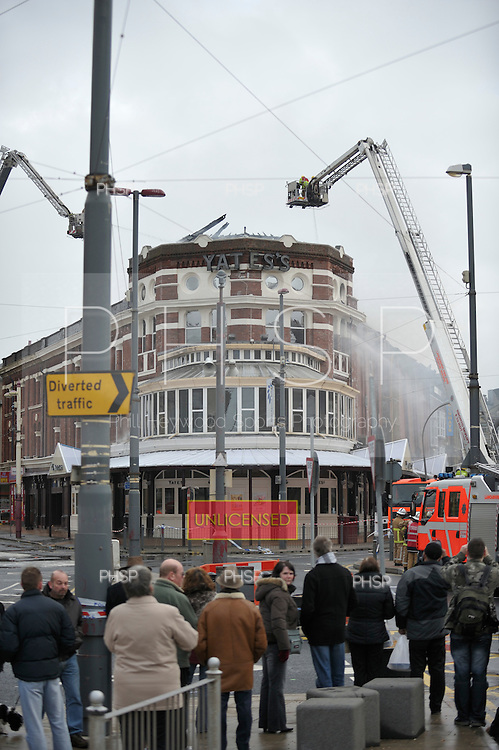Yates's Fire 15/02/09..Firecrews dampen down the roof of Yates's,Talbot Sq Blackpool